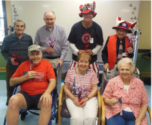 group of people dressed in red, white and blue attire